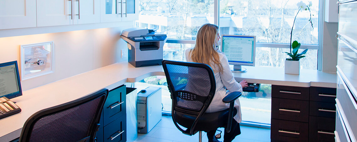 Doctor at computer desk