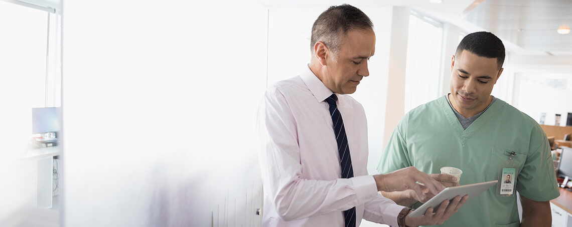 Doctor and nurse looking at a tablet