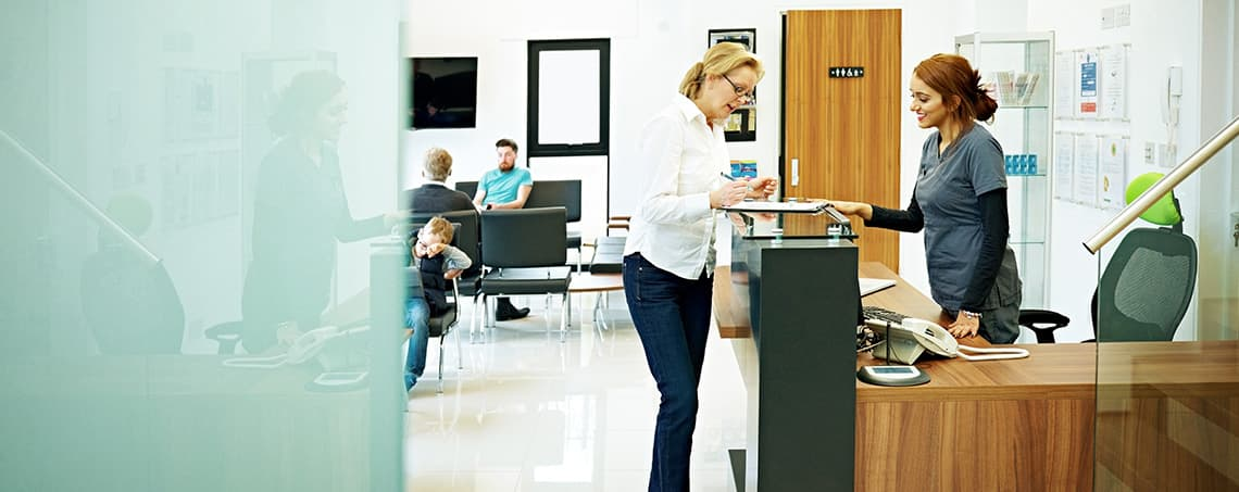 Patient checking in at reception